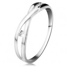 Prsten v bílém zlatě 585 - kulatý diamant čiré barvy, rozdělená překřížená ramena
