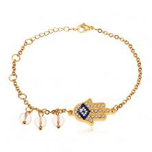 Náramek z chirurgické oceli, zlatý odstín, modro-čirá ruka Hamsa, čiré korálky