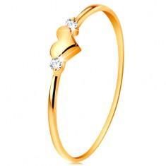 Prsten ve žlutém 14K zlatě - dva čiré zirkony a lesklé vypouklé srdíčko