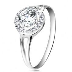 Prsten z bílého 14K zlata - zirkon čiré barvy lemovaný drobnými zirkonky