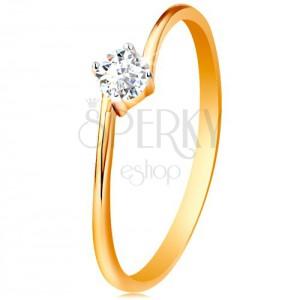 Prsten ze žlutého 14K zlata - kulatý čirý zirkon uchycený mezi konci ramen