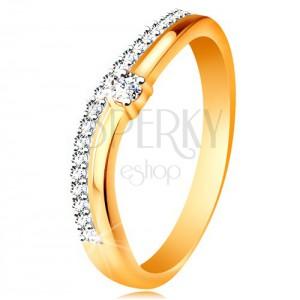 Prsten ze 14K zlata, zvlněná ramena s výřezem uprostřed a čiré zirkony