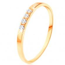 Zlatý prsten 585 - linie čtyř čirých briliantů, tenká lesklá ramena