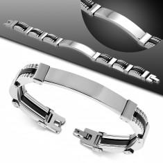 Ocelovo-pryžový náramek, úzké dílky stříbrné barvy, černé spoje, známka