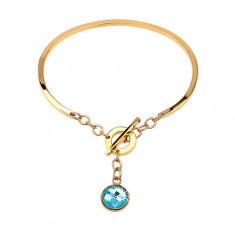 Ocelový náramek zlaté barvy, neúplný ovál s visícím modrým zirkonem