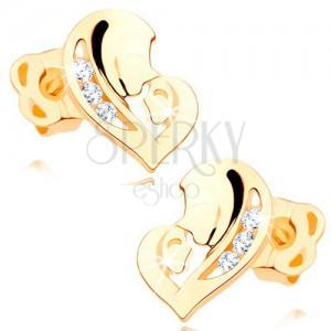Diamantové náušnice ve žlutém 14K zlatě - srdce ze dvou tváří, čiré brilianty