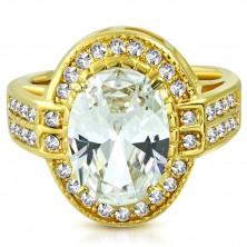 Ocelový prsten ve zlatém barevném odstínu - oválný zirkon v kotlíku, drobné zirkony