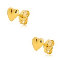 Náušnice ve žlutém 9K zlatě - lesklé asymetrické srdíčko, puzetové zapínání