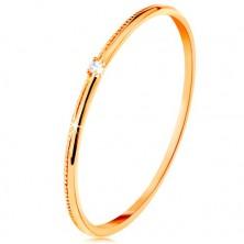 Prsten ve žlutém 9K zlatě - drobný čirý zirkon, jemně vroubkovaná ramena