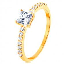 Prsten ve žlutém 9K zlatě - vystupující zirkonový čtverec, linie čirých zirkonků