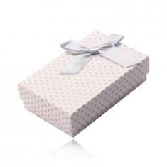 Obdélníková krabička na náušnice, náhrdelník a prsteny, bílý povrch, šedé puntíky a mašle