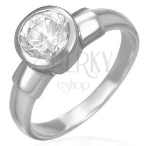 Ocelový snubní prsten s velikým zirkonovým očkem v kovové objímce