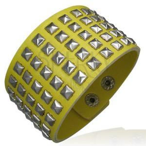 Žlutý koženkový náramek - vybíjený