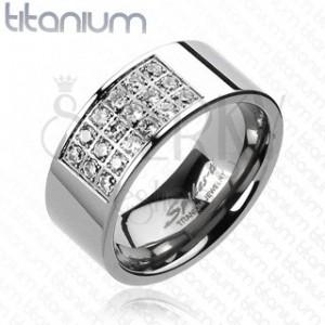 Prsten z titanu s obdélníkovým výřezem vykládaným zirkony
