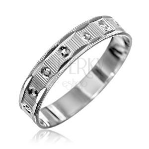 Stříbrný prsten 925 - vroubky s malými kužely, zářezy na okrajích