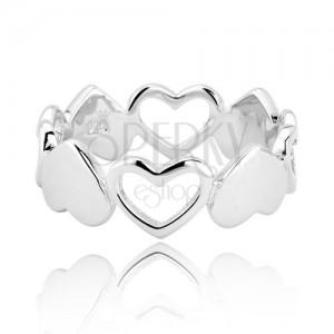 Stříbrný prsten 925 - propojená plná a prázdná srdce