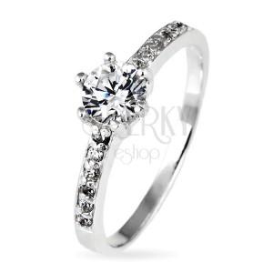 Stříbrný prsten 925 - kulatý zirkon v objímce a zirkonky po stranách